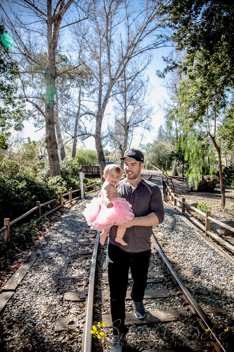 Photo of Baby Riley and her daddy on the train tracks