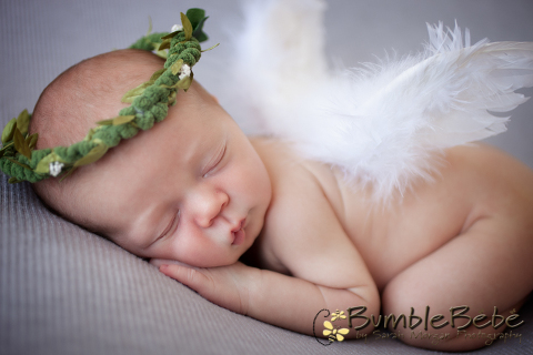 Baby Thomas dressed up in our Angel wings