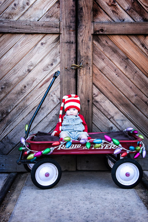 Sweet-Christmas-Baby-in-Radio-Flyer-wagon-in-Old-Poway-Park-Sayr