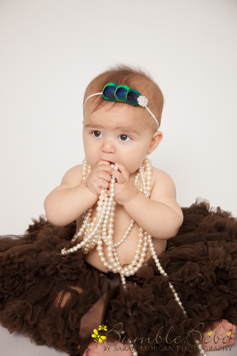 Baby Brooklyn sitting up with pearls