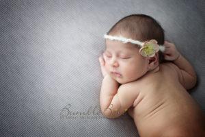 Adorable newborn baby girl in headband
