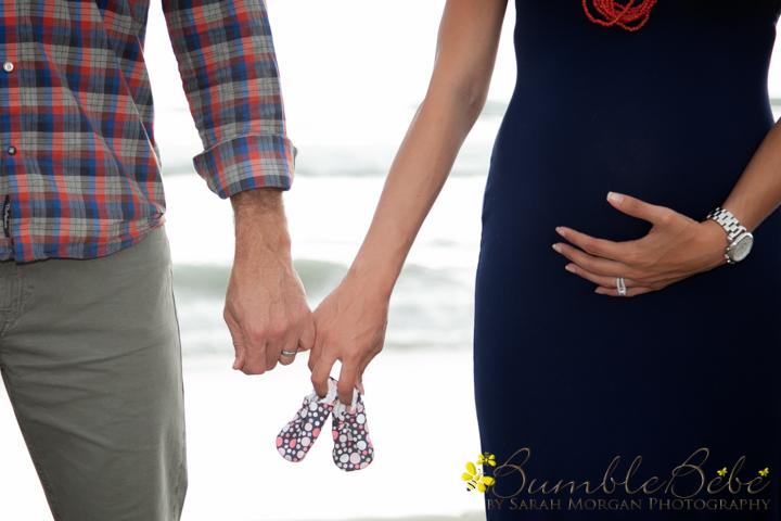 parents hands and baby booties