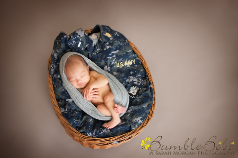 Baby Kira snuggled into her mom's navy uniform