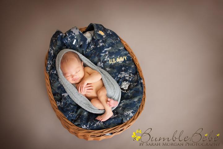 Baby Kira snuggled into her mom's navy uniform