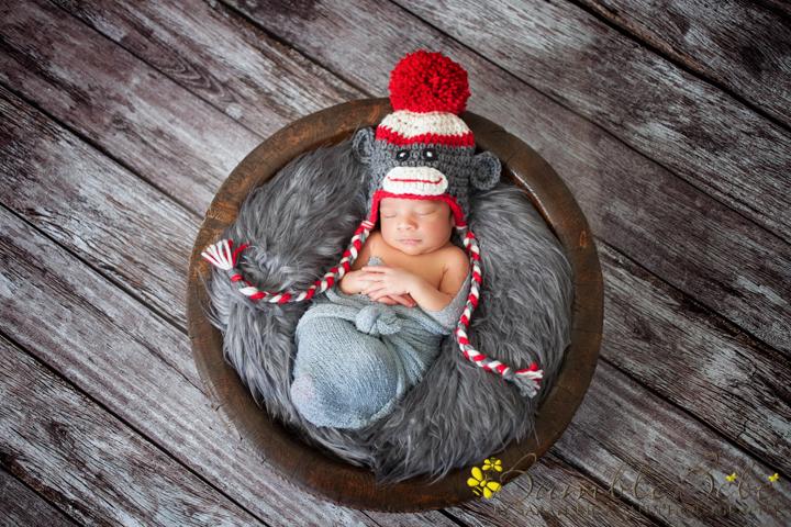 Sweet baby Kabir in our Sock Monkey hat