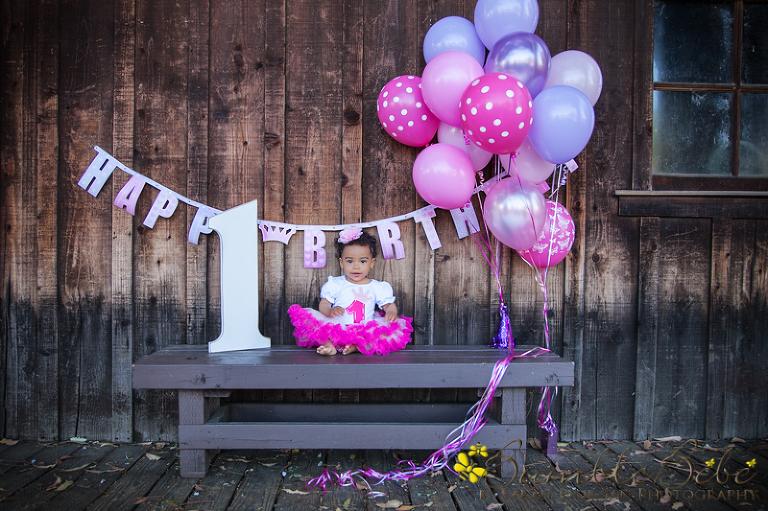 Baby Morgan amid balloons and banners