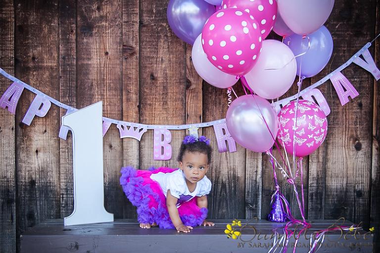 Baby Maxwelle enjoying her first birthday portrait