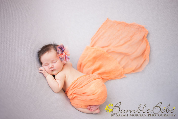 Newborn Taylor wrapped in orange