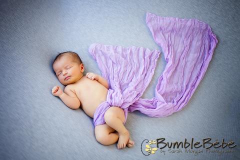Purple wrapped sweet sleepy baby