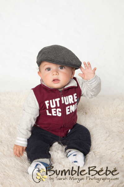 Baby Elliott's 9 Month Old Portraits. Elliott looks very dapper in his varsity jacket and cap