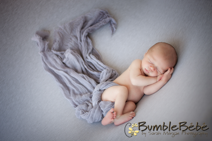 This is such a gorgeous image of newborn baby Thomas wrapped in our grey wrap.