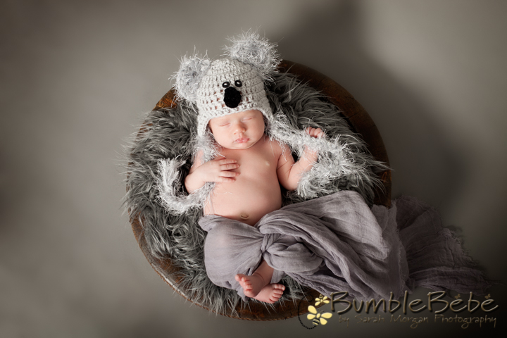 Baby Caleb in our bowl sporting our Koala bear hat.